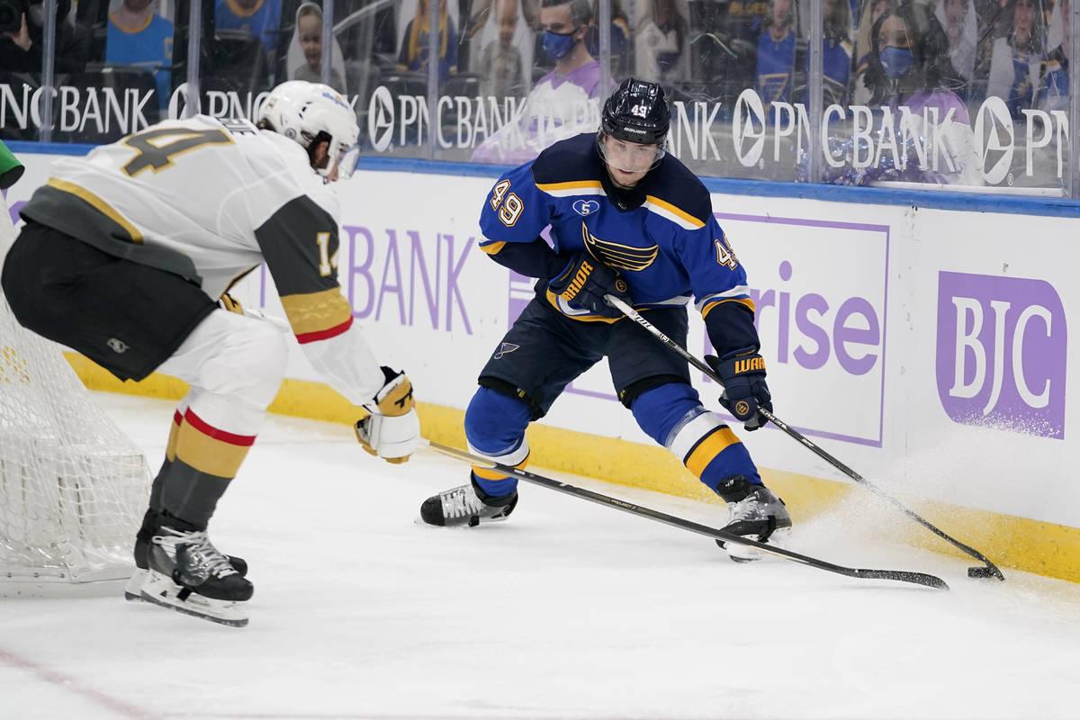 St. Louis Blues' Ivan Barbashev (49) controls the puck as Vegas Golden Knights' Nicolas Hague ( ...