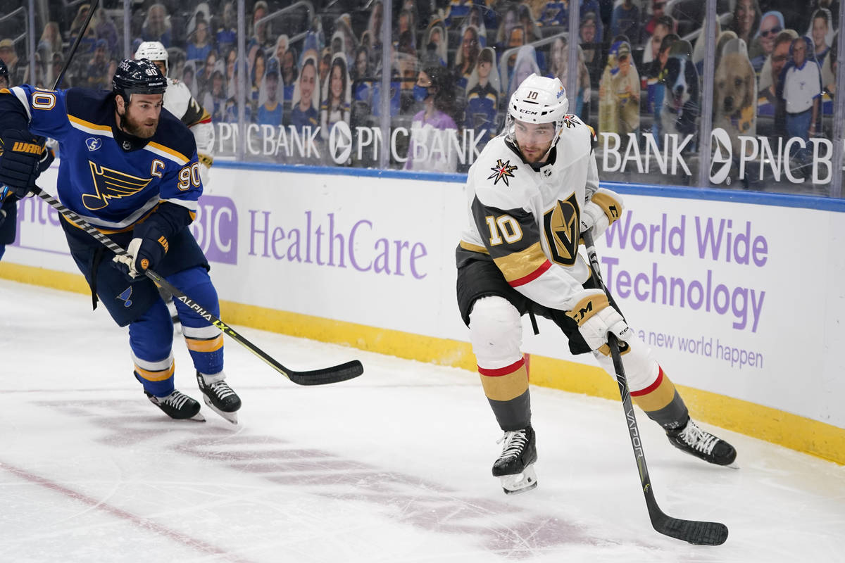 Vegas Golden Knights' Nicolas Roy (10) controls the puck as St. Louis Blues' Ryan O'Reilly (90) ...