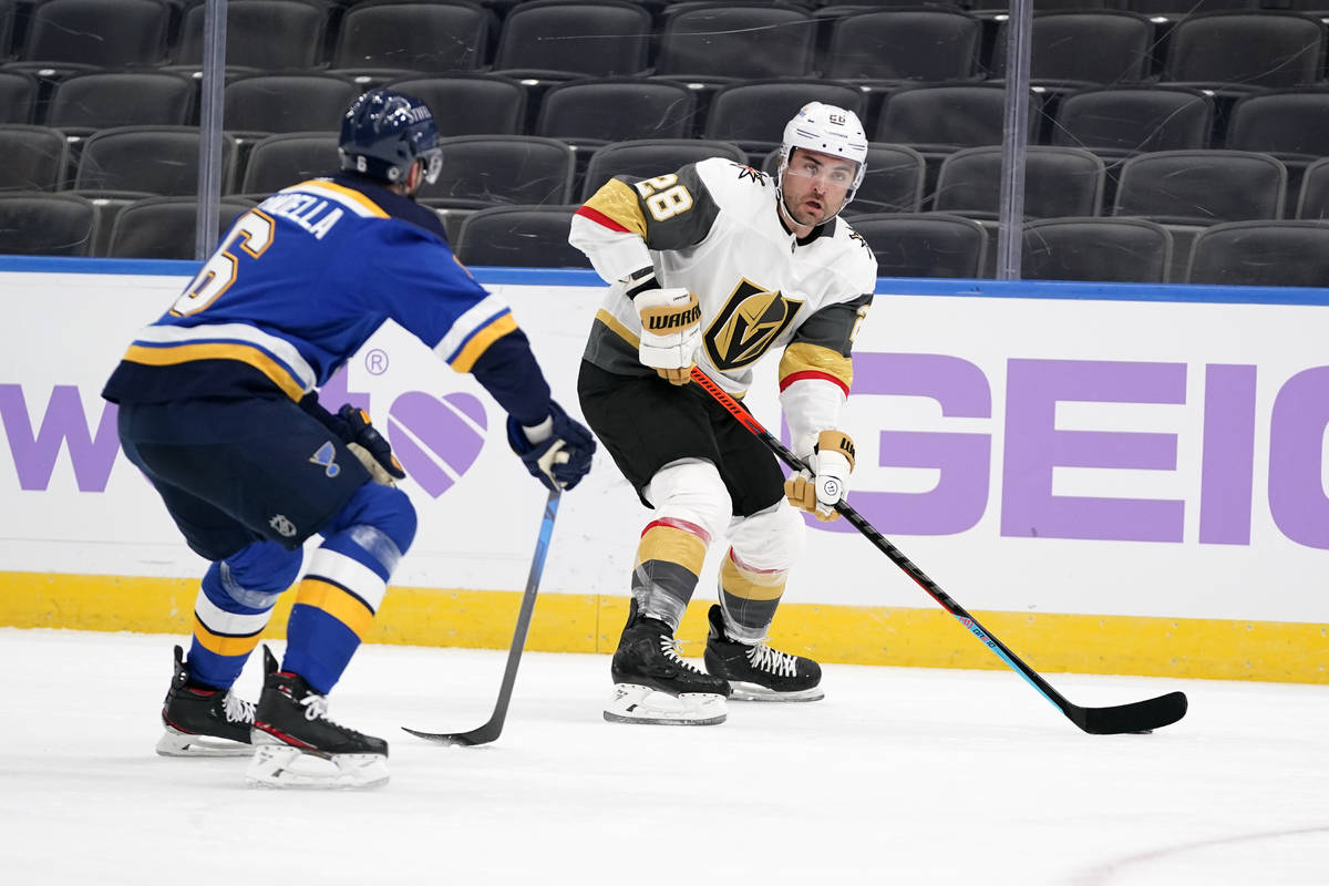Vegas Golden Knights' William Carrier (28) brings the puck down the ice as St. Louis Blues' Mar ...