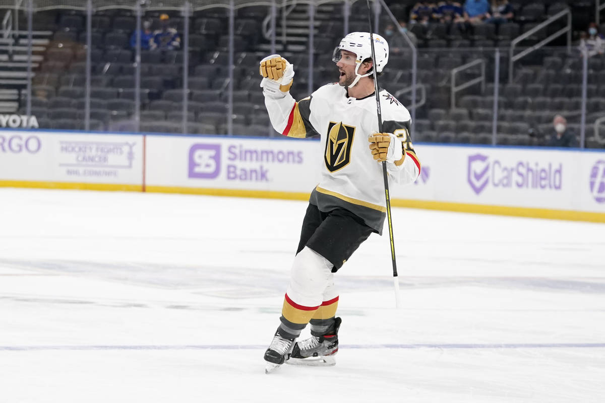 Vegas Golden Knights' Alec Martinez (23) celebrates after scoring during the first period of an ...