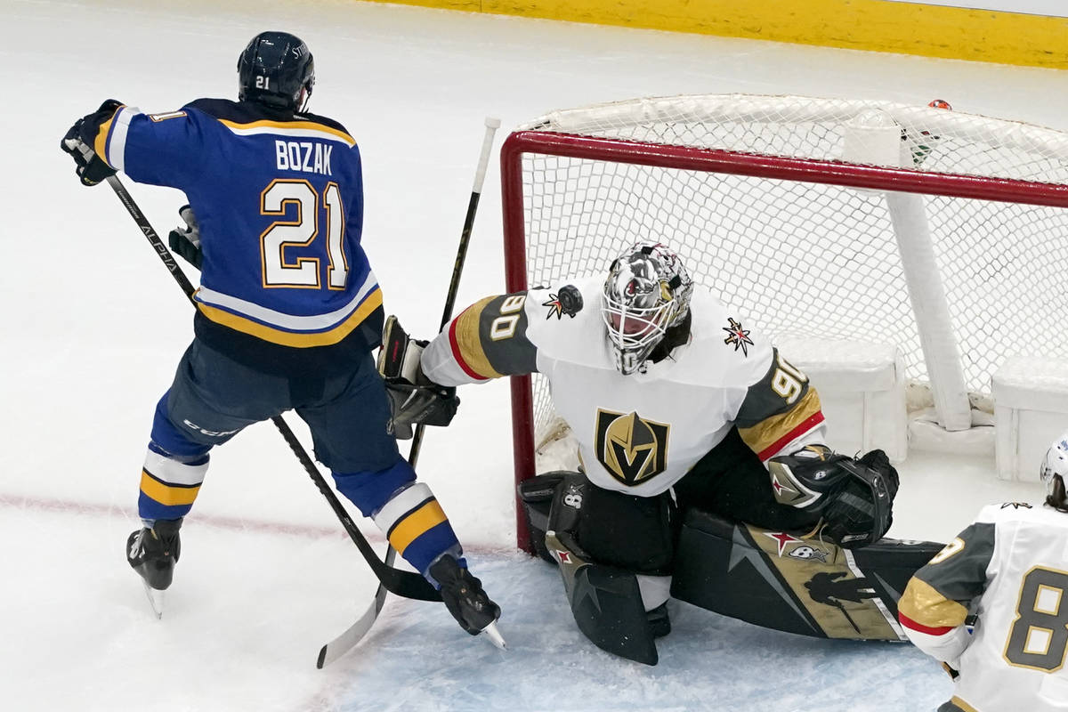 A puck hangs in the air in front of Vegas Golden Knights goaltender Robin Lehner (90) as St. Lo ...