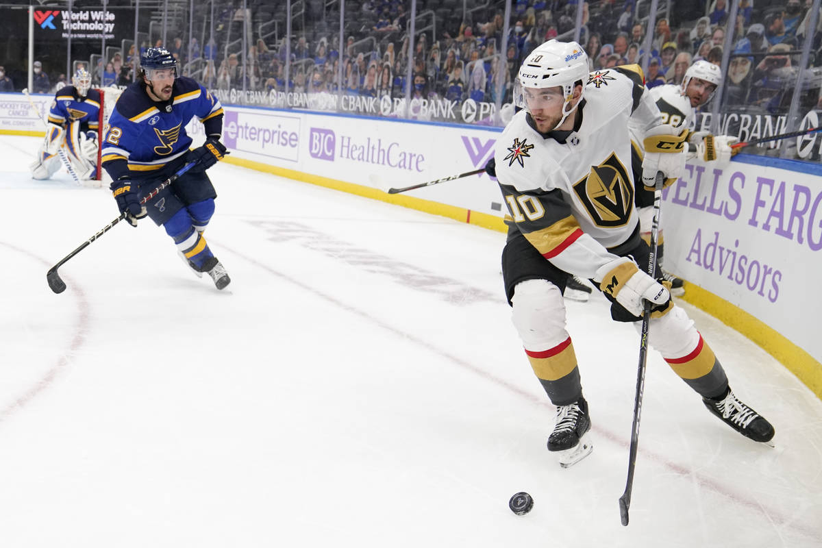 Vegas Golden Knights' Nicolas Roy (10) looks to pass as St. Louis Blues' Justin Faulk (72) defe ...