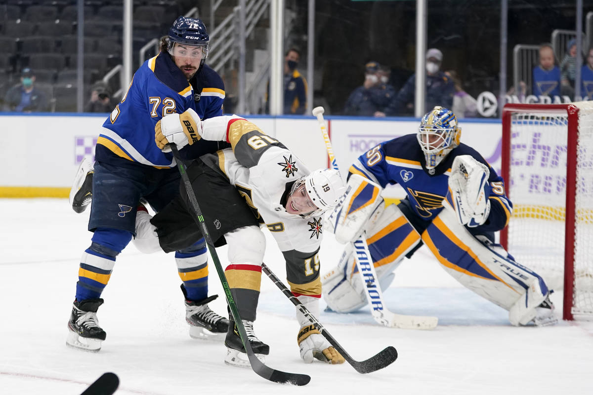 Vegas Golden Knights' Reilly Smith gets tangled up with St. Louis Blues' Justin Faulk (72) as B ...