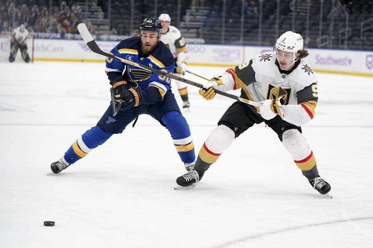 Vegas Golden Knights' Cody Glass (9) and St. Louis Blues' Ryan O'Reilly (90) chase after a loos ...