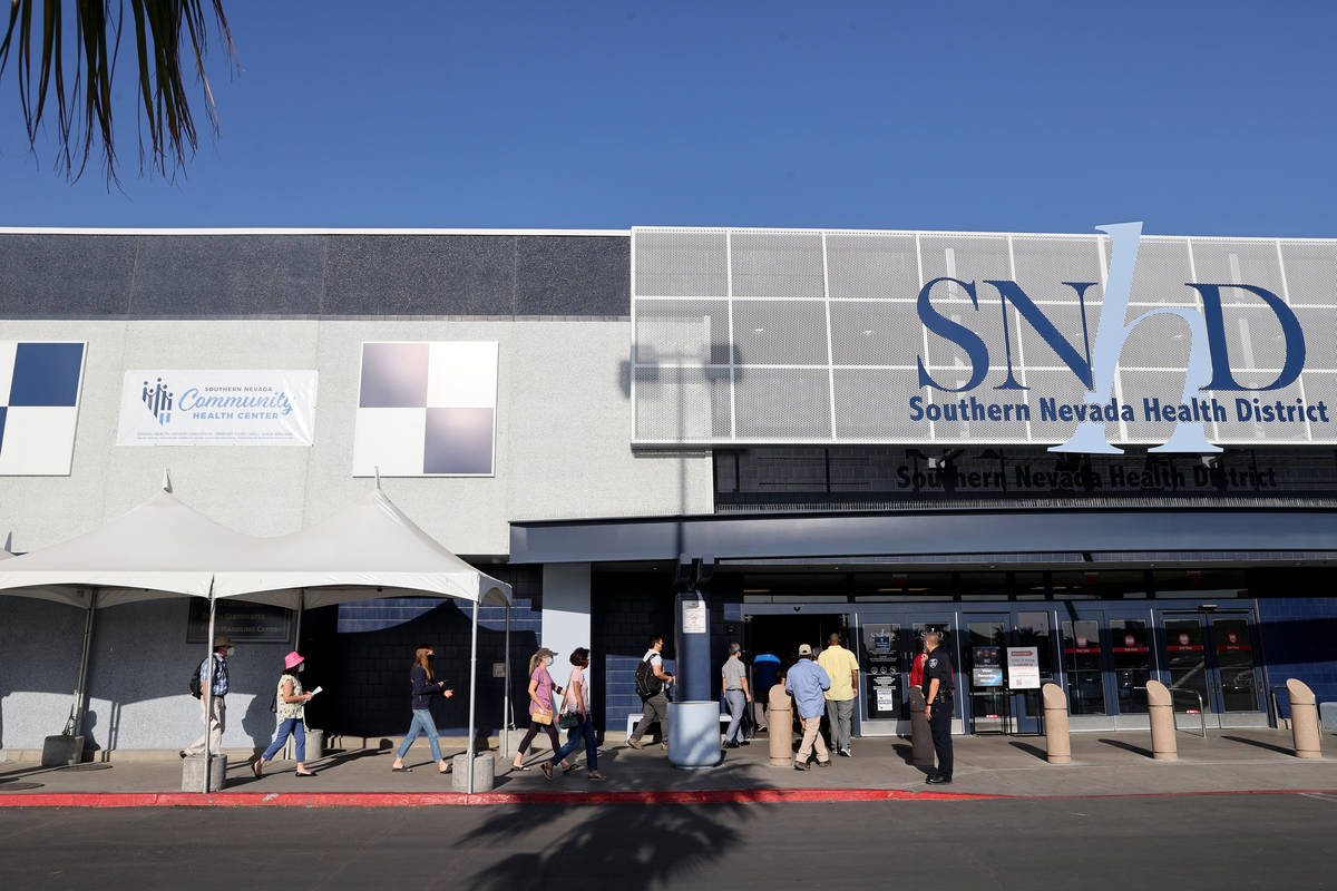People line up for COVID-19 vaccinations at the Southern Nevada Health District site Monday, Ap ...
