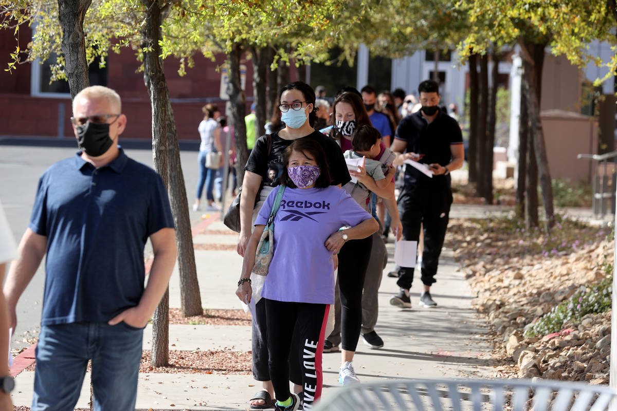 People line up at the UNLV vaccination site Monday, April 5, 2021. All Nevadans 16 and older ar ...