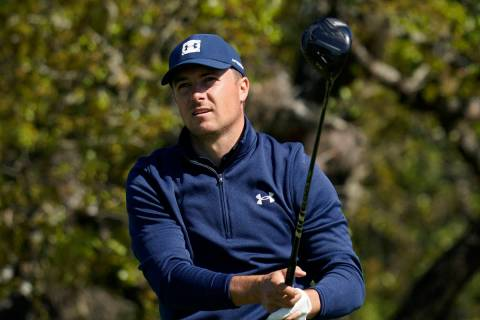 Jordan Spieth watches his drive from the second tee during the first round of the Texas Open go ...