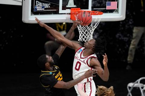 Missouri forward Jeremiah Tilmon misses a dunk in front of Oklahoma forward Victor Iwuakor (0) ...