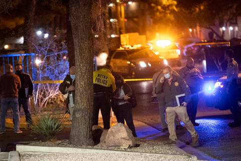 Las Vegas police investigate the scene of a homicide at the 3600 block of Paradise Road in Las ...