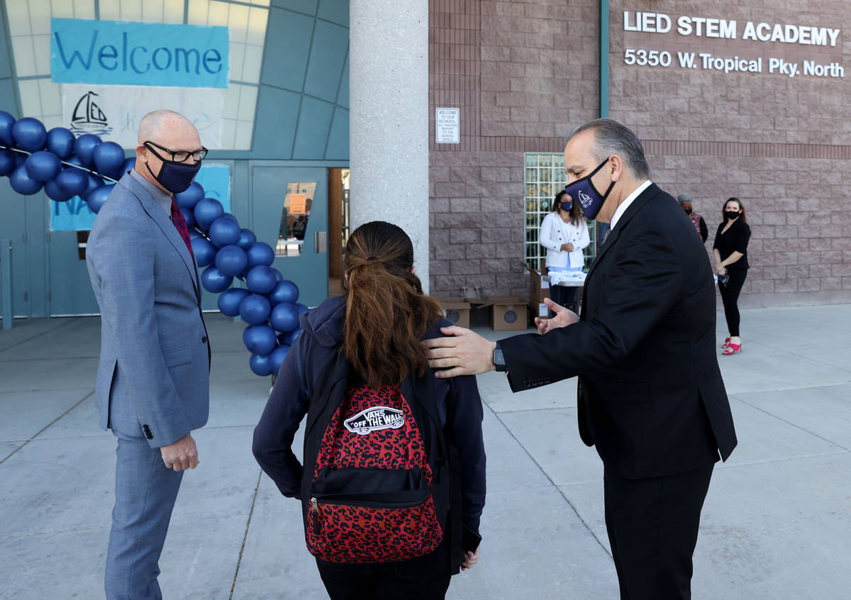 Superintendent Jesus Jara, right, and Principal Derek Fialkiewicz welcome students for their fi ...