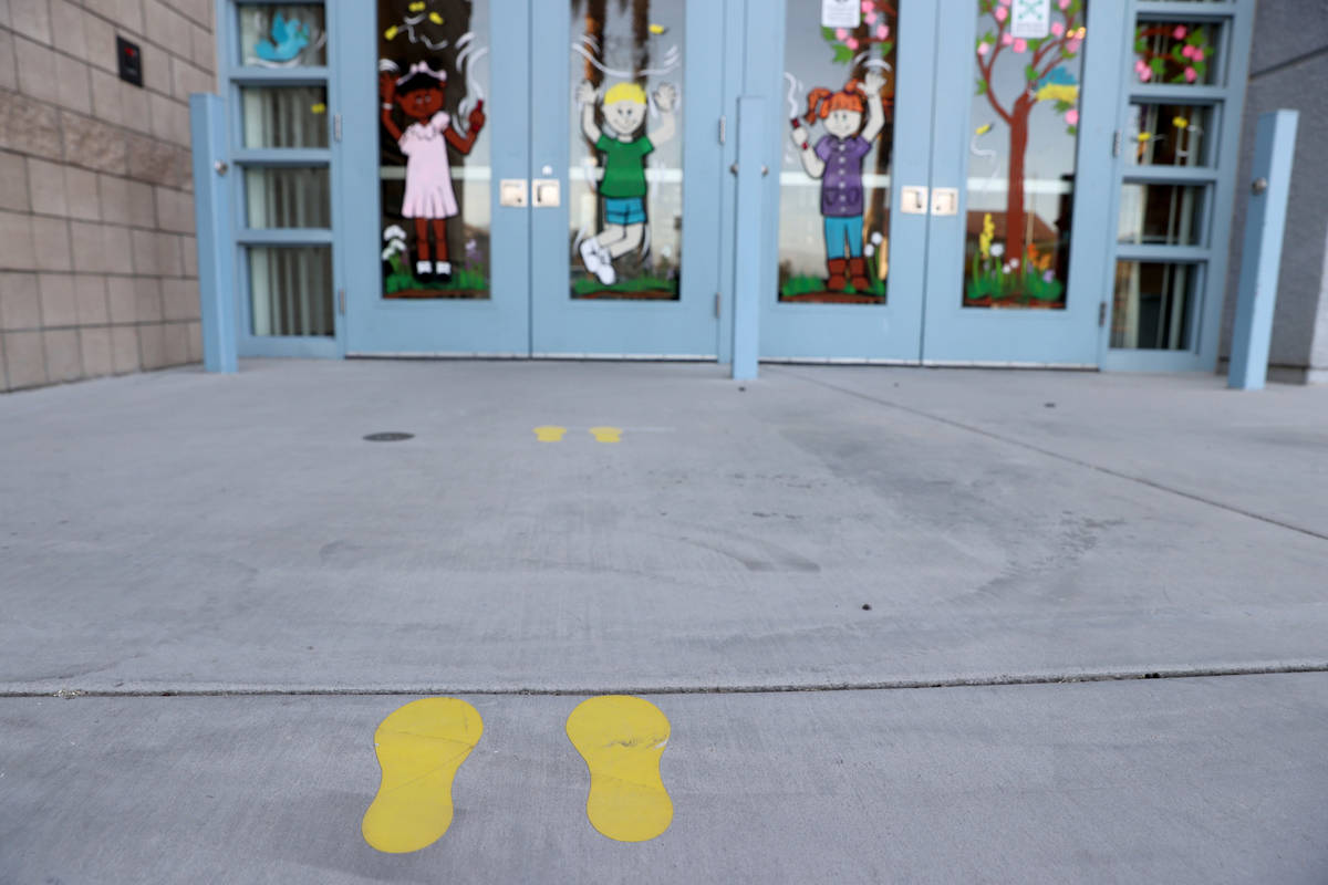 Social distancing foot prints at Neal STEAM Academy in Las Vegas Tuesday, April 6, 2021. After ...