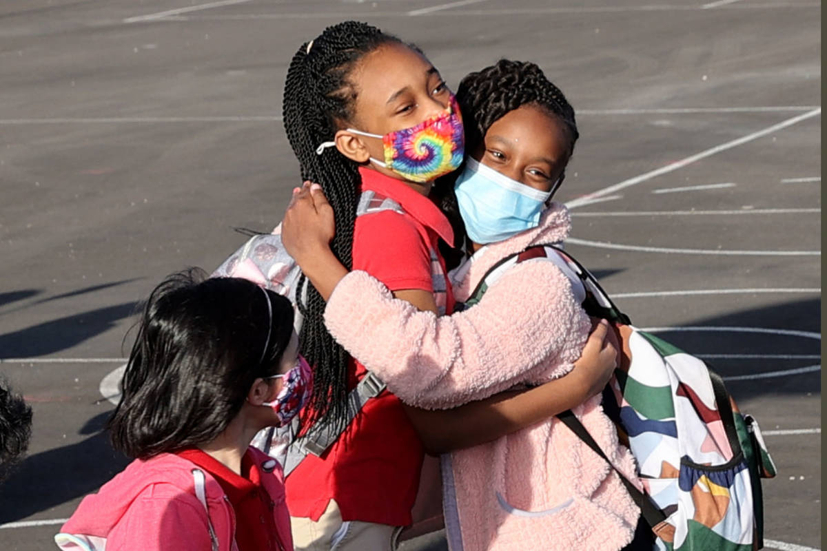 Fourth graders Malinda Bruce, left, and Kailyn Hines, both 10, greet each other for their first ...