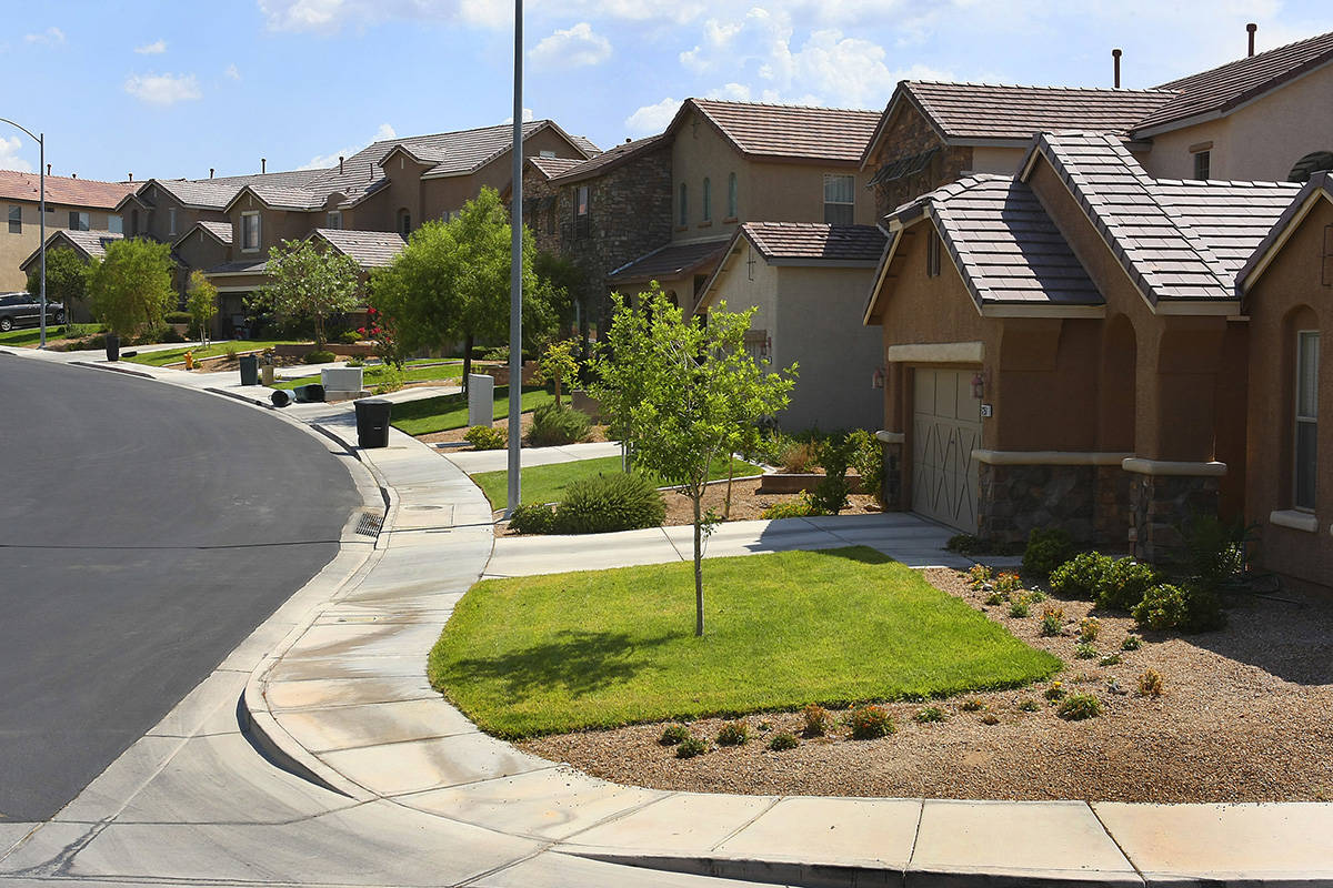 Grass lawns are shown in the front yards of homes in the Anthem master-planned community in Hen ...