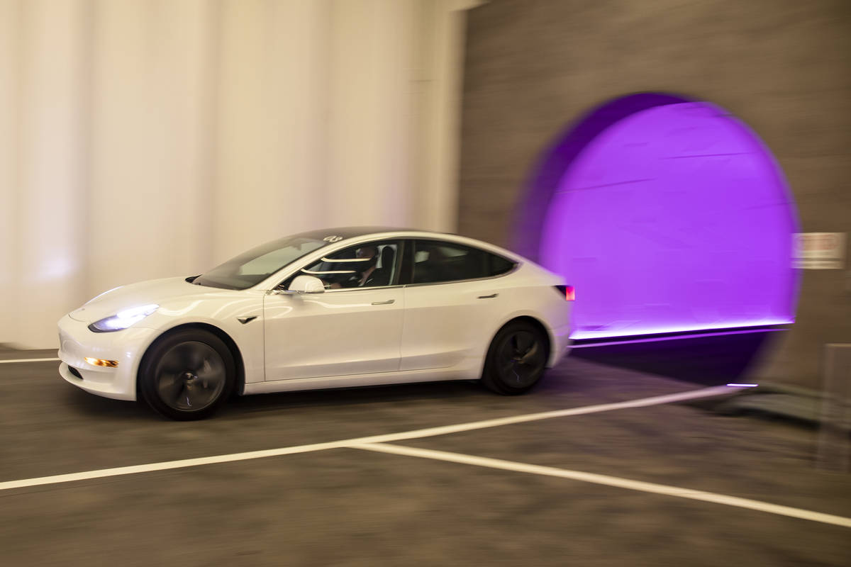 A Tesla electric car enters Central Station of the Boring Company's Convention Center Lo ...