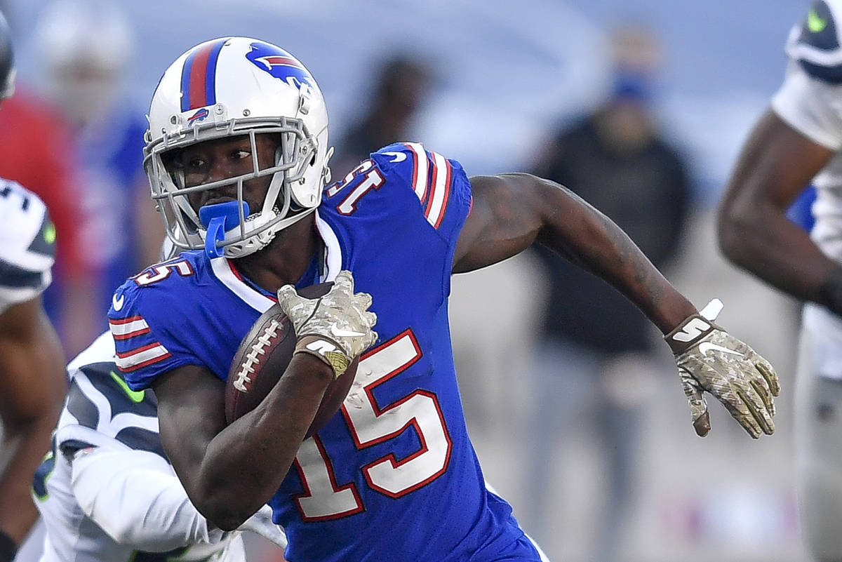 FILE - In this Nov. 8, 2020, file photo, Buffalo wide receiver John Brown (15) runs with the ba ...