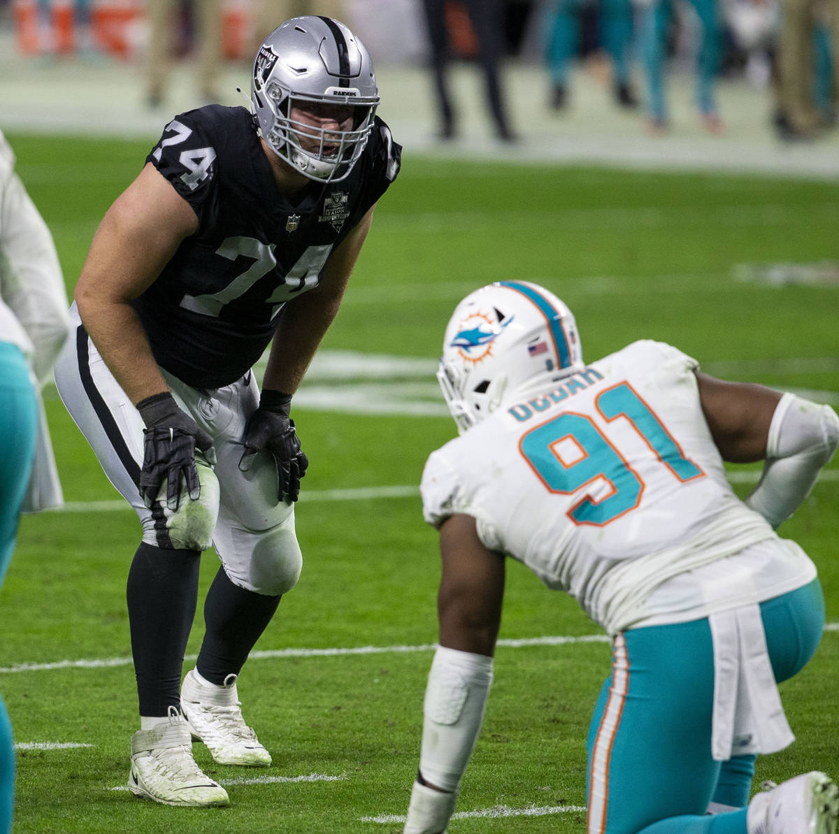 Raiders offensive tackle Kolton Miller (74) sets up against Miami Dolphins defensive end Emmanu ...