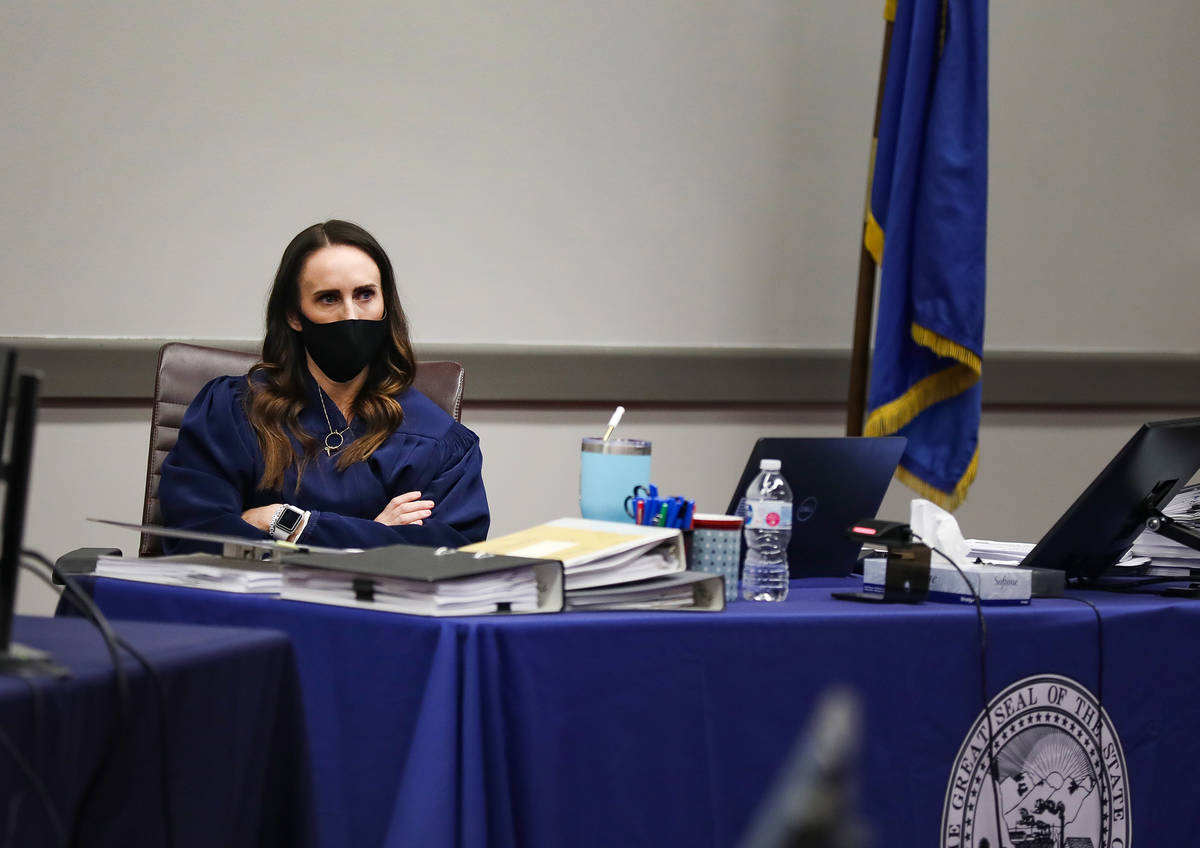 District Judge Jacqueline Bluth listens to closing arguments in a civil case against MedicWest ...