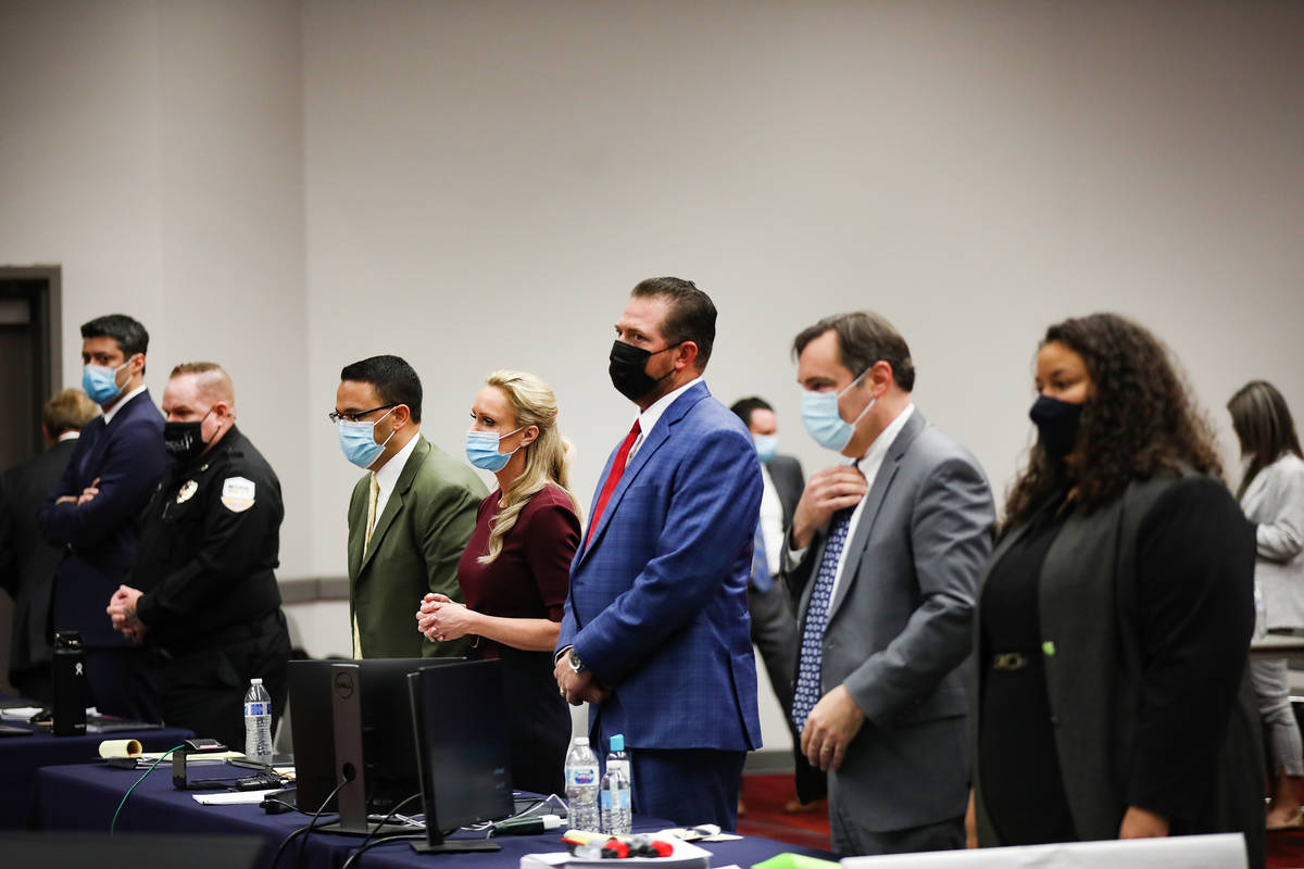 Attorneys in a case against MedicWest Ambulance stand as the jury enters the trial room at the ...