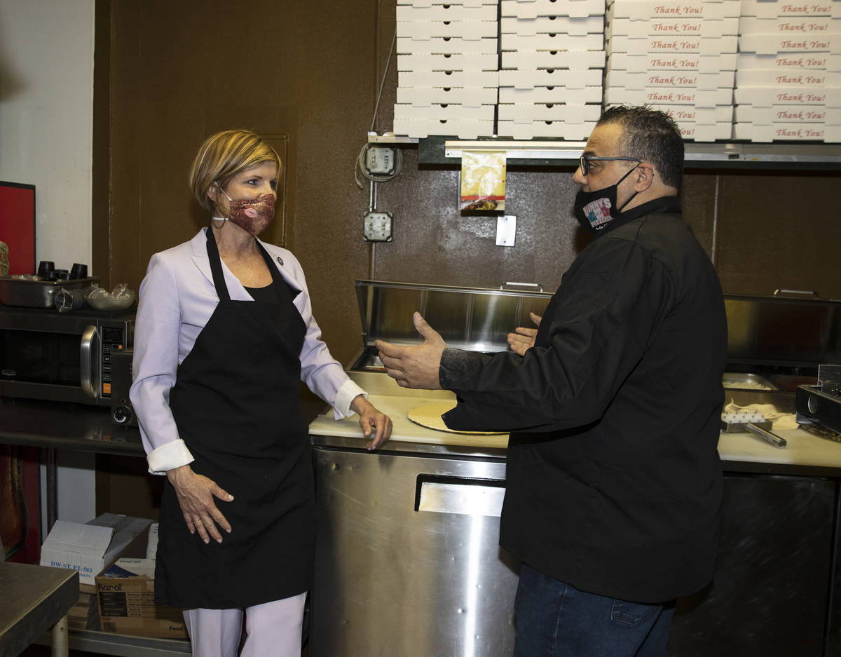 Rep. Susie Lee listens to Vincenzo Cimino, owner of Vinny's Pizzeria, as she visited the restau ...