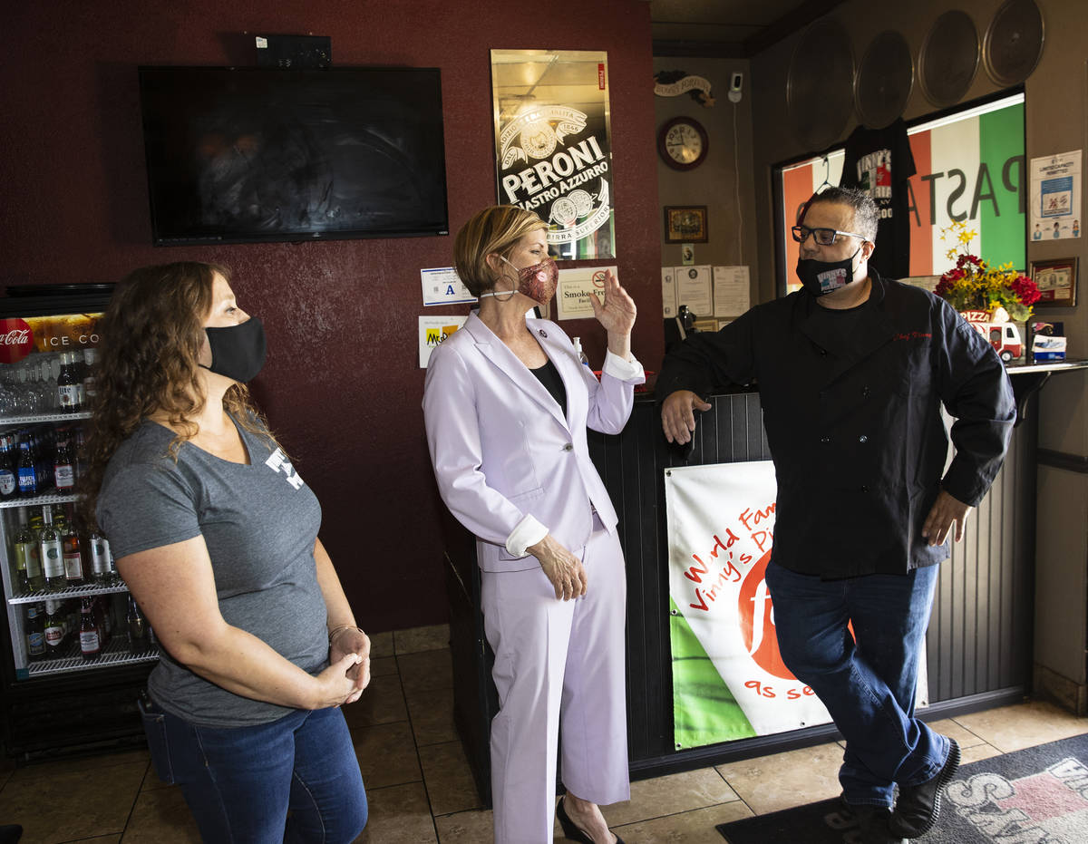 Rep. Susie Lee speaks as Vincenzo Cimino, right, owner of Vinny's Pizzeria, and his wife Tina l ...