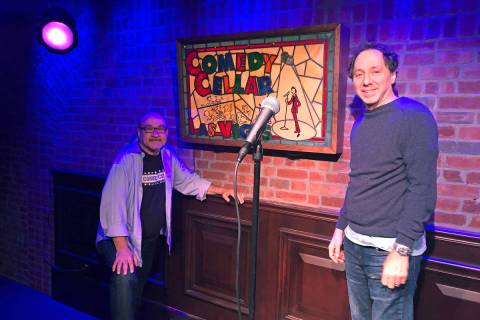 Comedy Cellar co-owners Bill Grundfest, left, and Noam Dworman are shown onstage at the club at ...