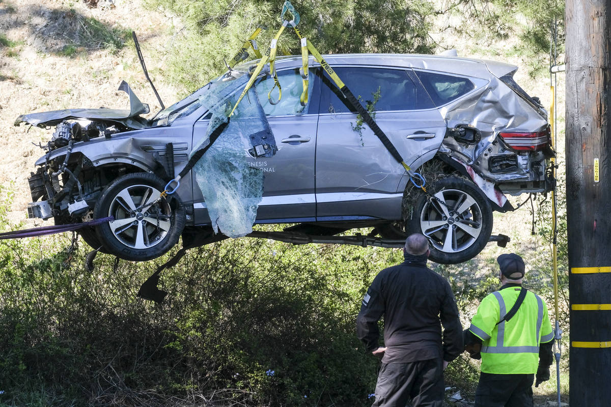 In this Feb. 23, 2021, file photo, a crane is used to lift a vehicle following a rollover accid ...