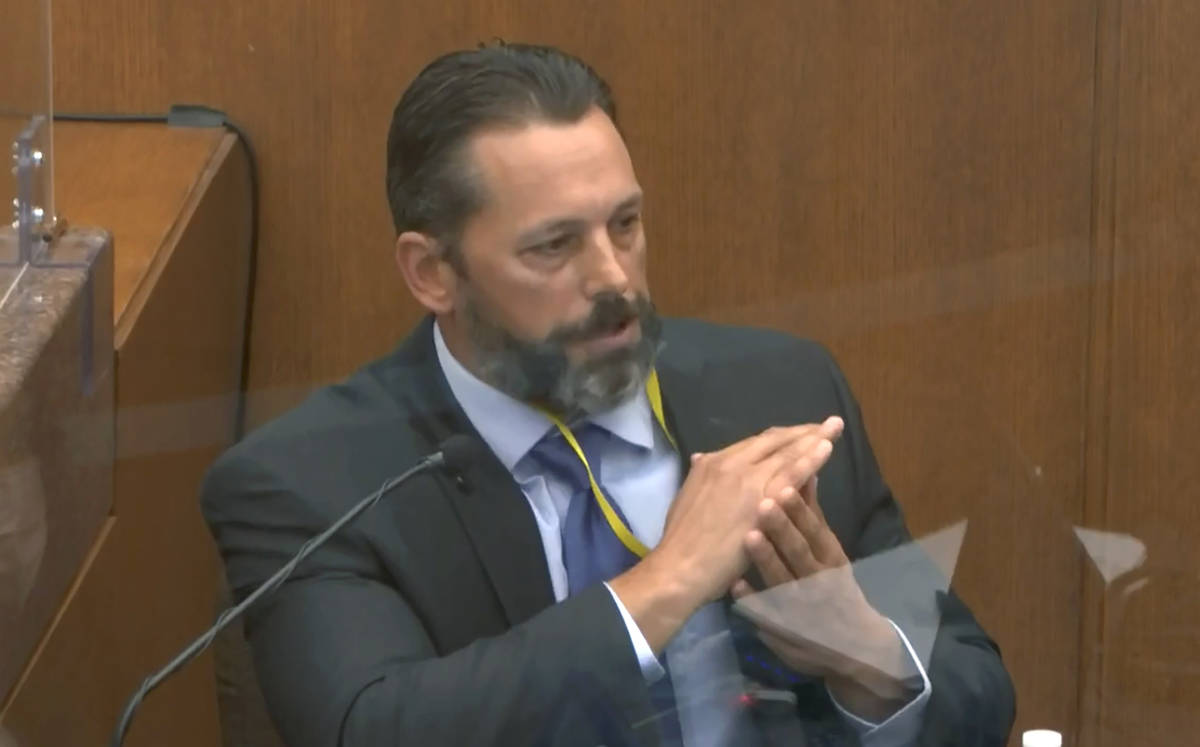 In this image from video, Minneapolis Police Lt. Johnny Mercil, a use of force trainer, testifi ...