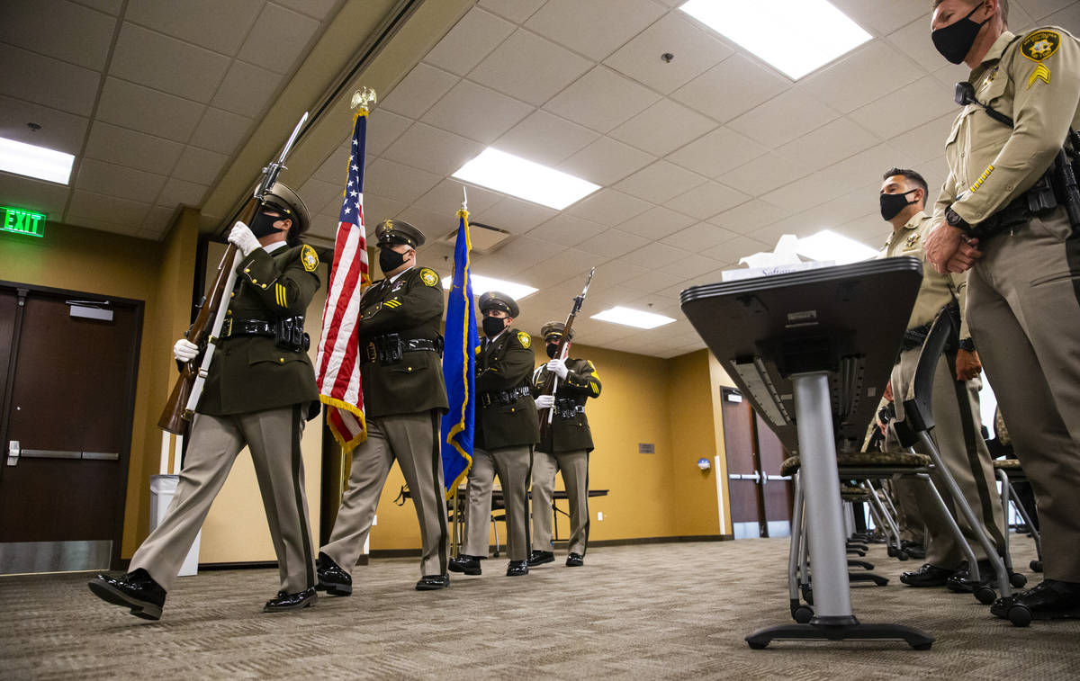 """The Metropolitan Police Department honor guard presents colors during a ceremony for """"brav ..."""