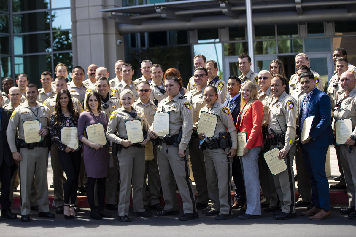 Metropolitan Police Department officers and employees pose for a group picture with their award ...