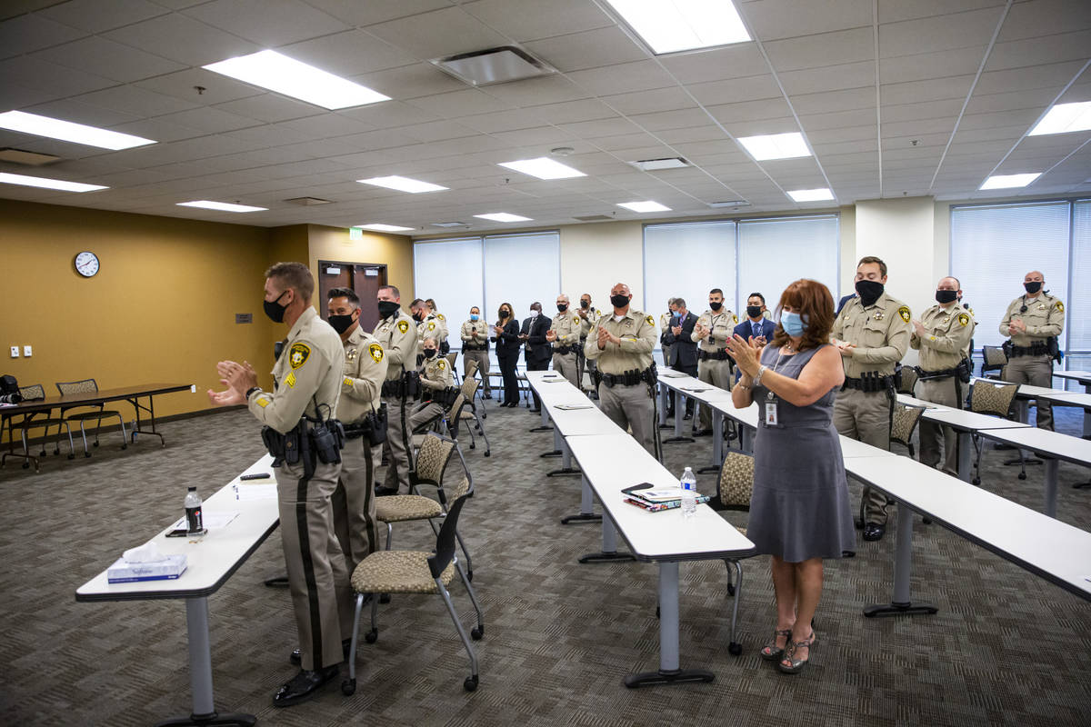 """Attendees clap at the end of a ceremony for """"bravery and excellence"""" at Metropolitan ..."""