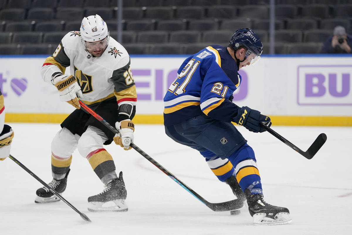 Vegas Golden Knights' William Carrier (28) reaches for the puck as St. Louis Blues' Tyler Bozak ...