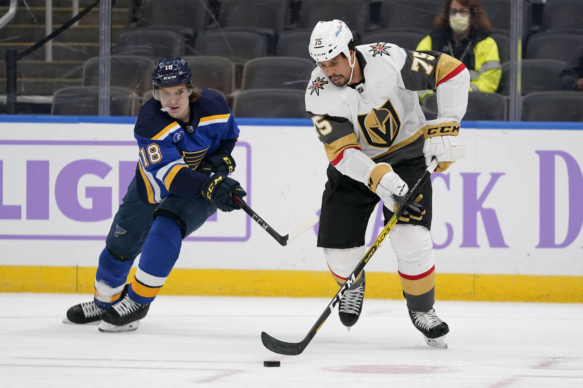 Vegas Golden Knights' Ryan Reaves (75) and St. Louis Blues' Robert Thomas (18) chase after a lo ...