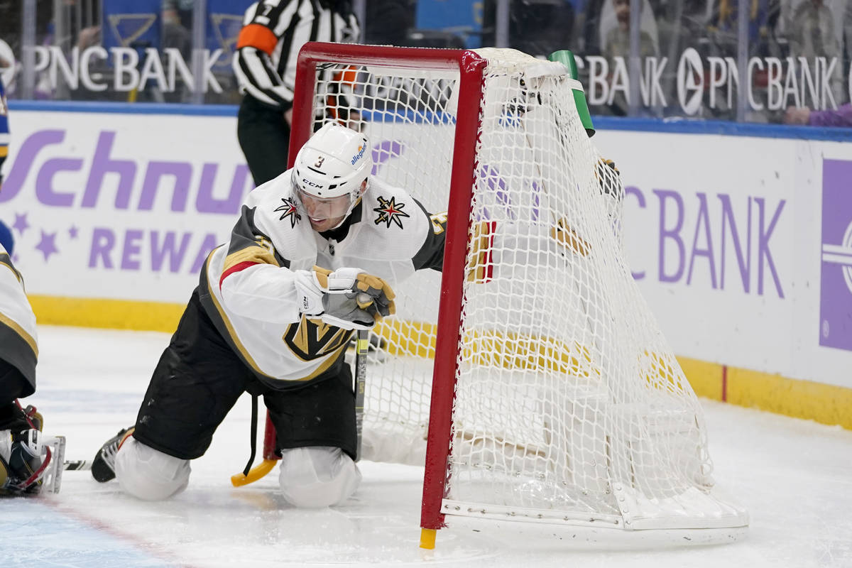Vegas Golden Knights' Brayden McNabb slides into the net during the second period of an NHL hoc ...