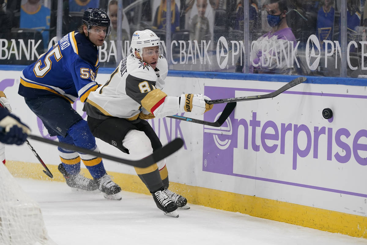 Vegas Golden Knights' Jonathan Marchessault (81) and St. Louis Blues' Colton Parayko (55) chase ...