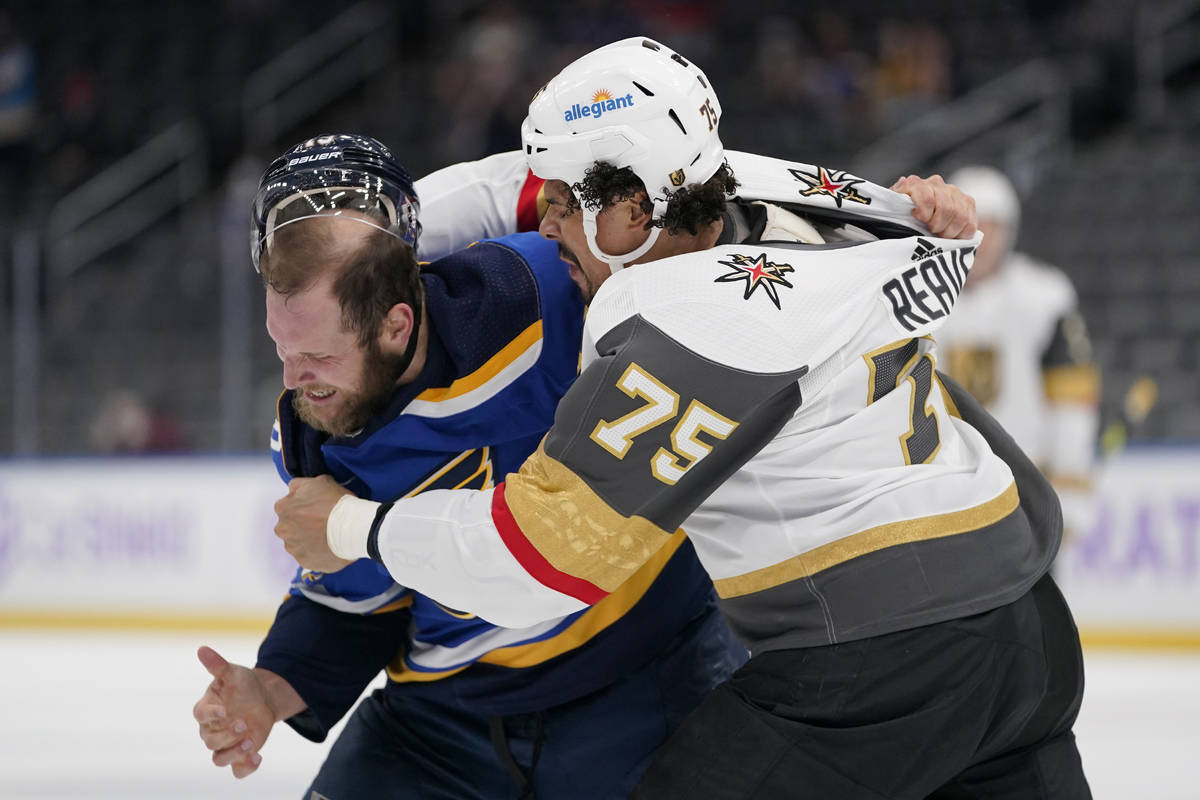 St. Louis Blues' Kyle Clifford, left, and Vegas Golden Knights' Ryan Reaves (75) fight during t ...