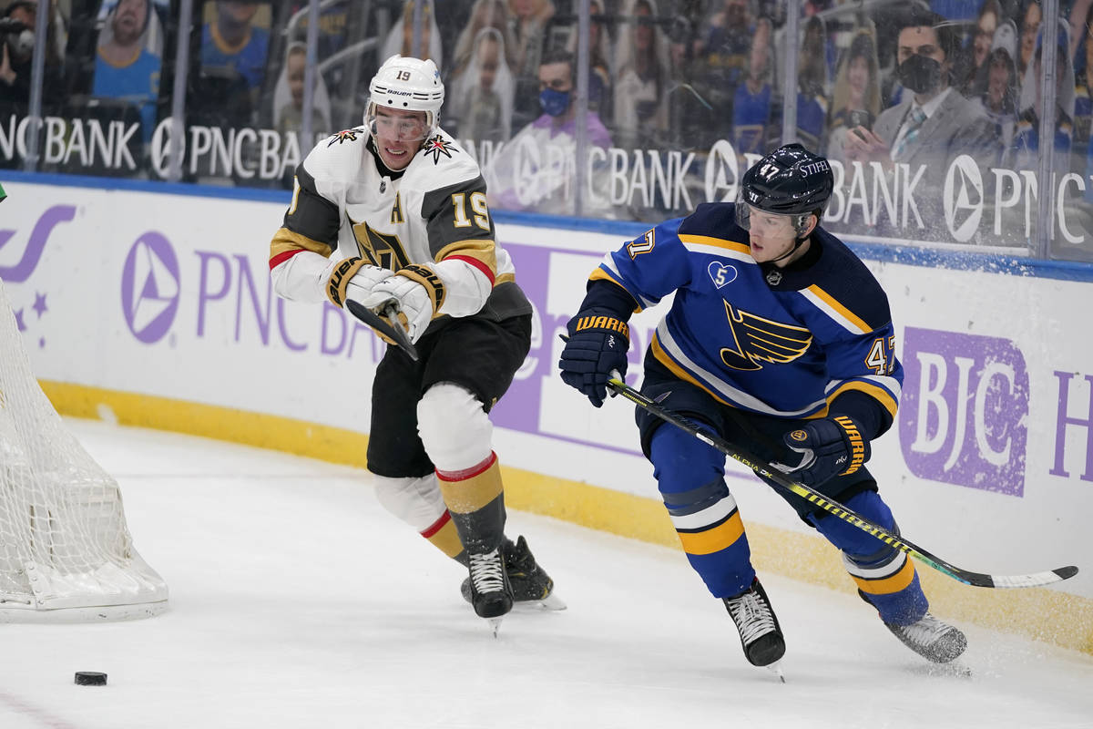 Vegas Golden Knights' Reilly Smith (19) and St. Louis Blues' Torey Krug chase after a loose puc ...