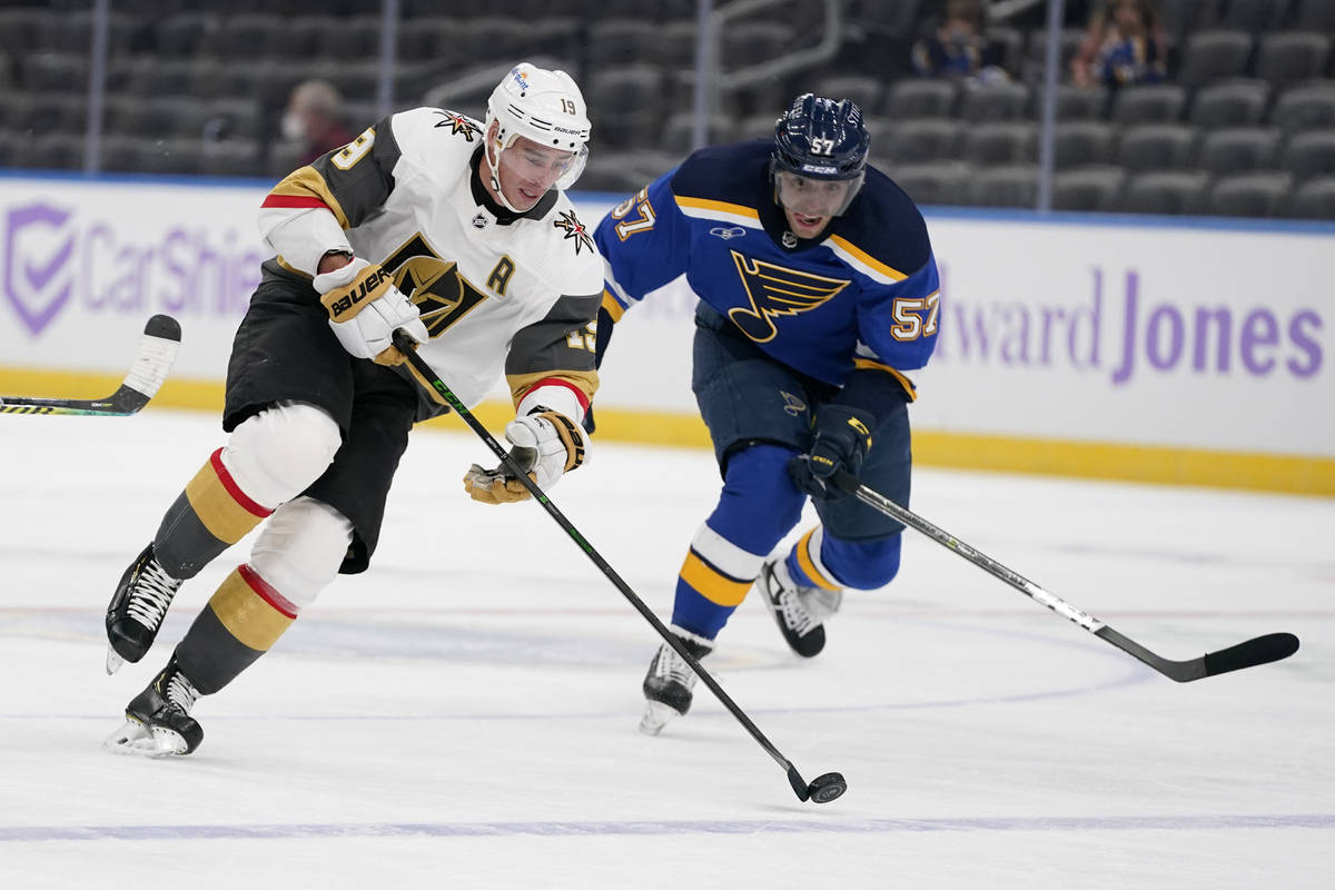 Vegas Golden Knights' Reilly Smith (19) brings the puck down the ice as St. Louis Blues' David ...