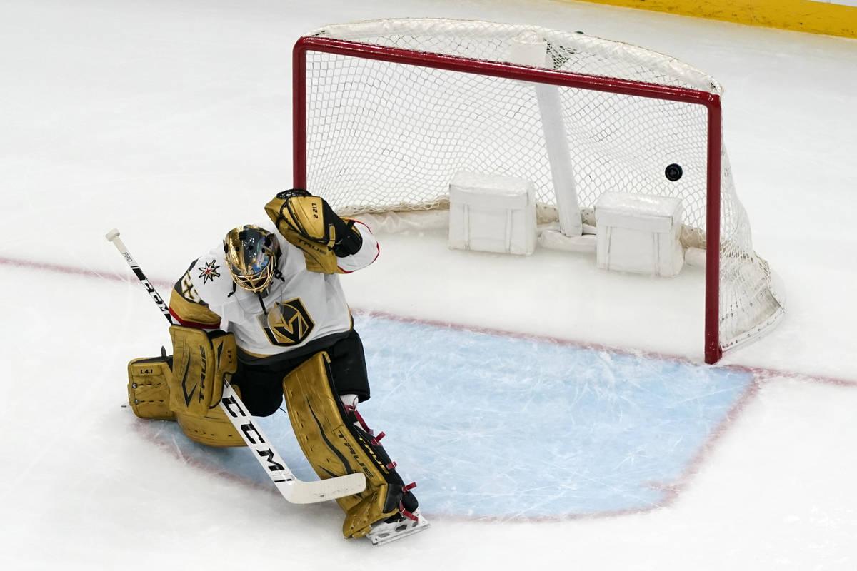 A puck shot by St. Louis Blues' Sammy Blais slips past Vegas Golden Knights goaltender Marc-And ...