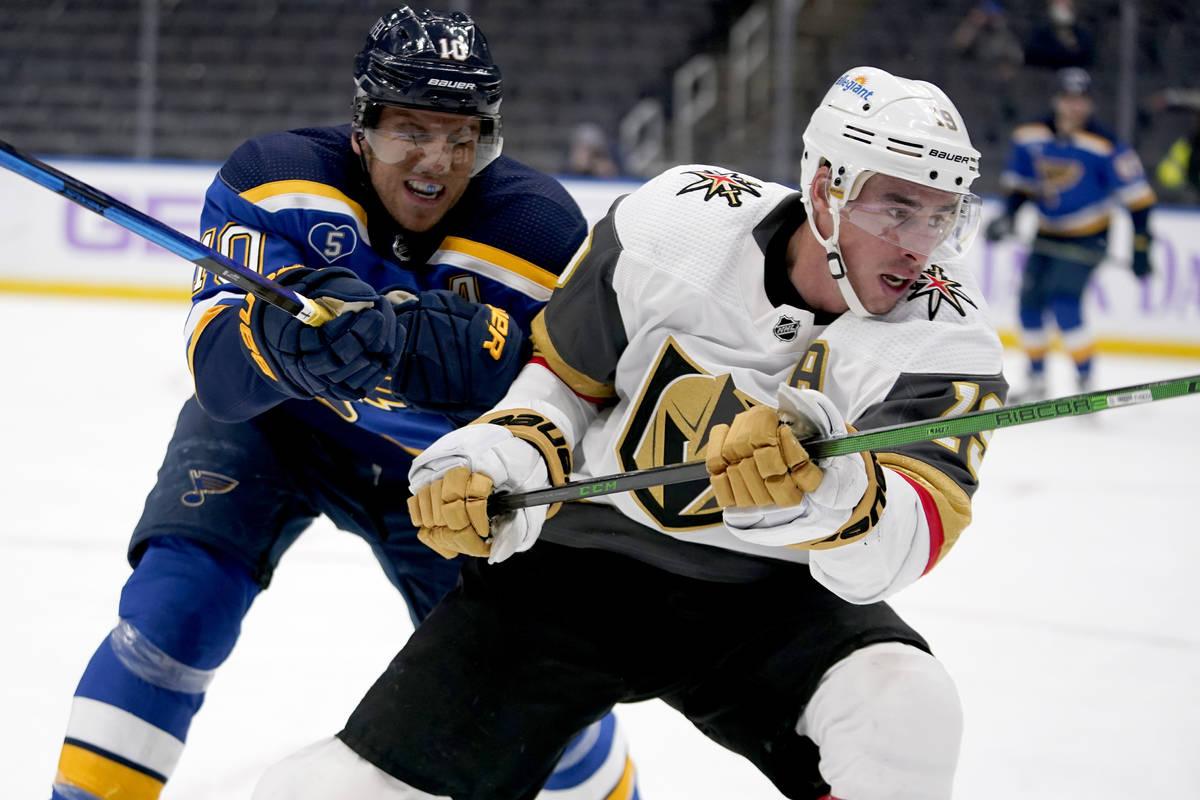 Vegas Golden Knights' Reilly Smith, right, skates as St. Louis Blues' Brayden Schenn (10) defen ...