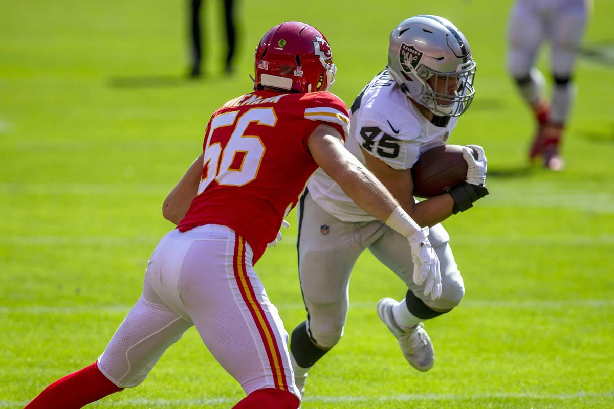 Las Vegas Raiders fullback Alec Ingold (45) runs with the football as Kansas City Chiefs lineba ...