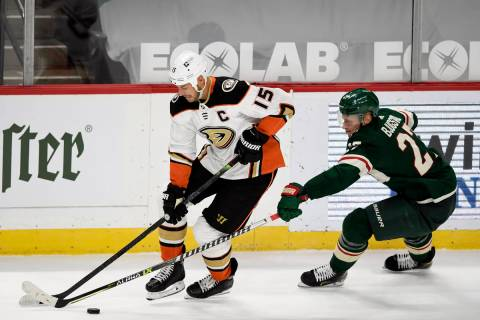 Anaheim Ducks' Ryan Getzlaf (15) is defended by Minnesota Wild's Nick Bjugstad (27) during the ...