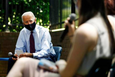 Joe Biden, left. (AP Photo/Matt Slocum)