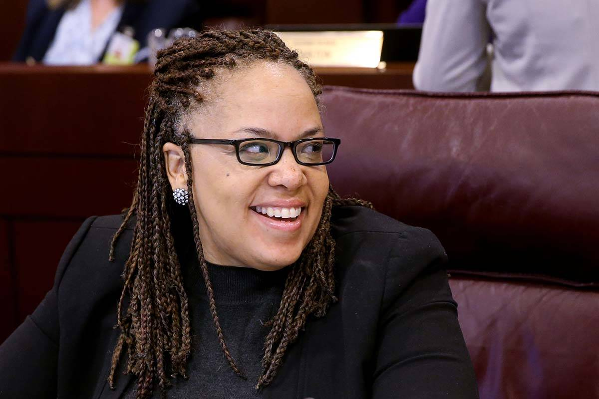 Assemblywoman Dina Neal D-North Las Vegas, prepares for a joint meeting of the Senate Finance C ...