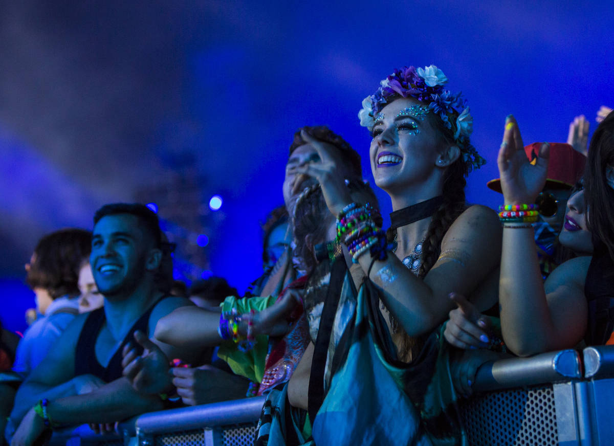 Attendees react as Excision performs at the Kinetic Field stage during the first day of the Ele ...