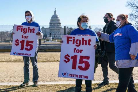 Activists appeal for a $15 minimum wage near the Capitol in Washington, Thursday, Feb. 25, 2021 ...