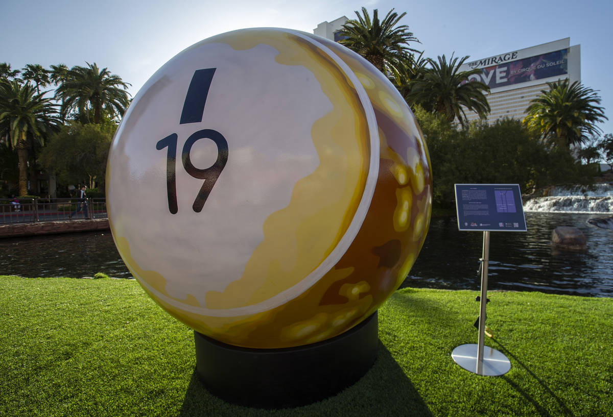 A 200-pound bingo ball by artist Jerry Misko is displayed in front of The Mirage Volcano on Tue ...