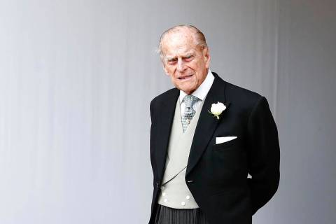 In this Friday, Oct. 12, 2018, file photo, Britain's Prince Philip waits for the bridal process ...