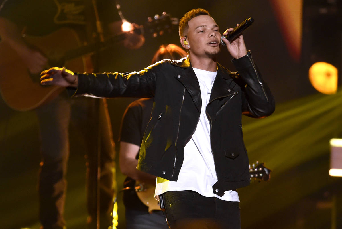 """In this Nov. 8, 2017, file photo, Kane Brown performs """"Heaven South"""" at the 51st annual CMA Awa ..."""