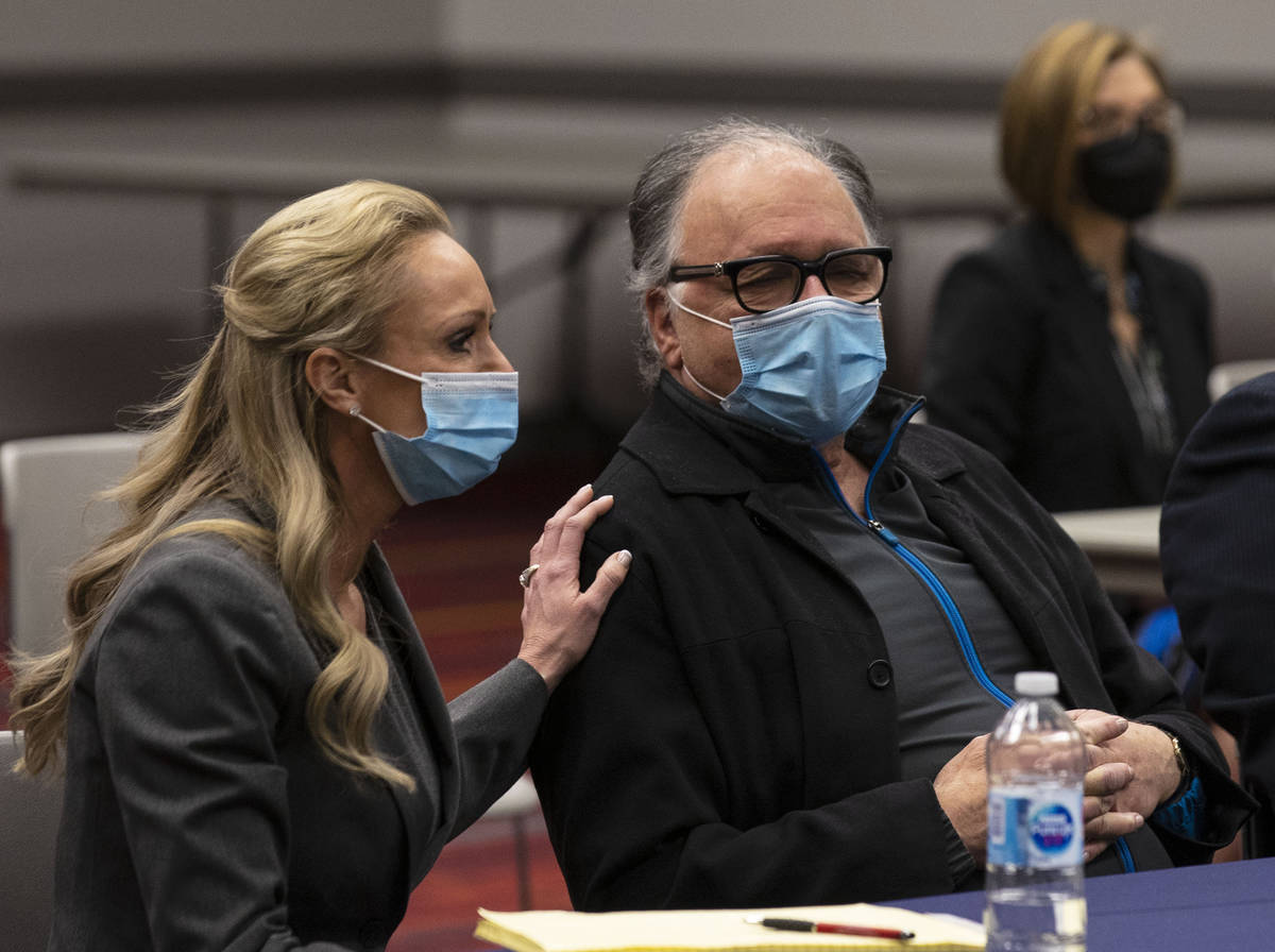 Attorney Christian Morris comforts Chantel Giacalone's father Jack on Friday, April, 9, 2021, a ...