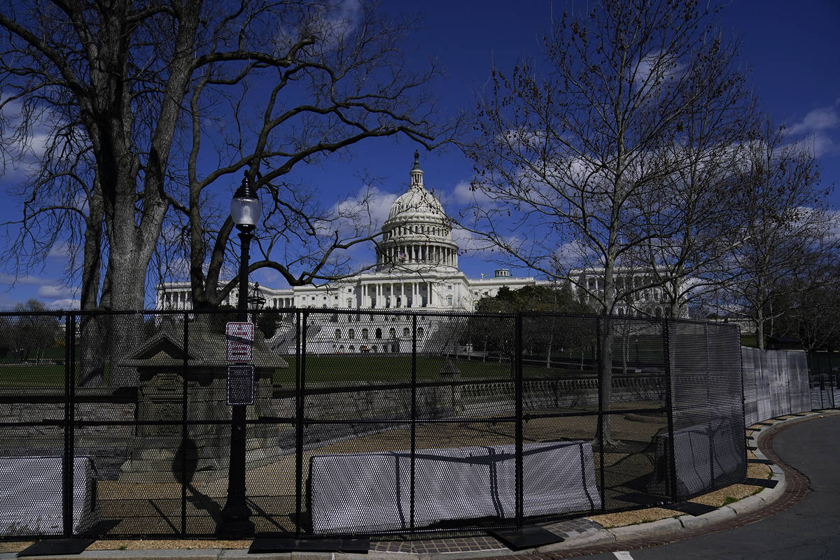 The U.S. Capitol is seen behind security fencing after a car that crashed into a barrier on Cap ...